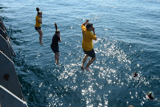 People jumping into the water